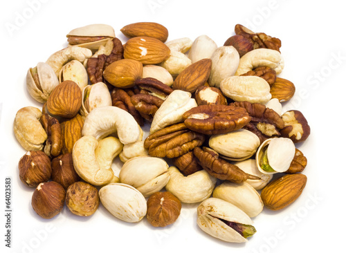 Heap of assorted nuts .