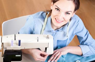 Seamstress sewing clothes