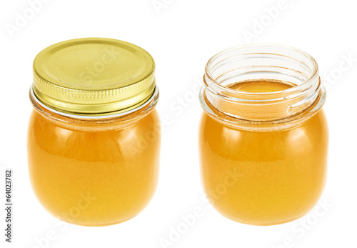 Closed and opened honey jar