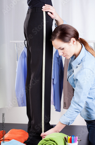 Tailor measuring pant suit