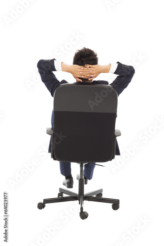 relaxing successful businessman leaning back