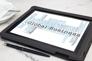 tablet with global business word cloud