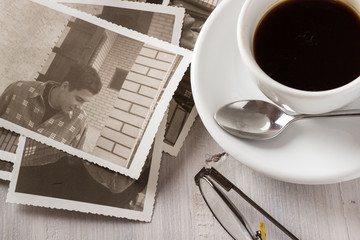 Memories. Cup of coffee and old photos