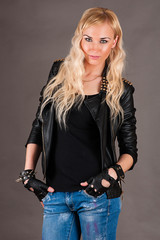 Beautiful stylish woman in a leather jacket