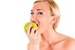 Beautiful healthy woman eating a green apple