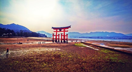 Big red gate (Torii) at Miyajima island, Hiroshima, Japan