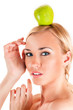 beautiful healthy woman with apple on head
