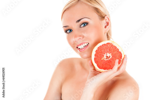 beautiful healthy woman with half a grapefruit in hands