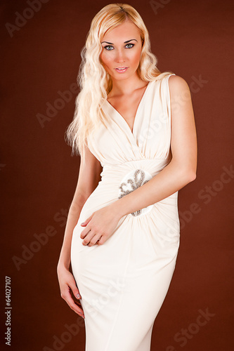 beautiful sexy woman in a beige dress