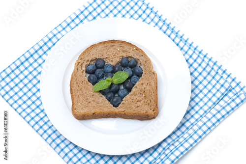 a piece of bread with the middle filled with blueberries