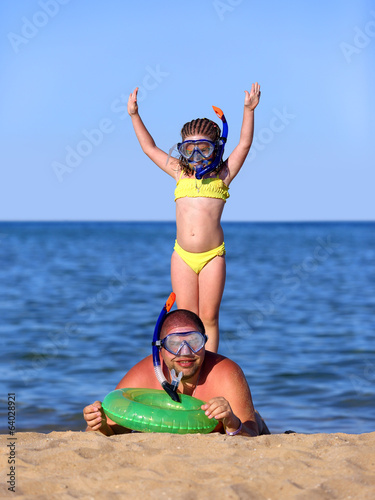 father and daughter on beach in scuba mask