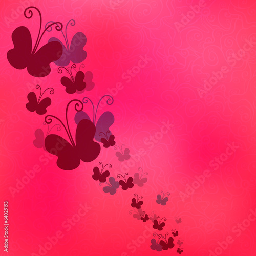 Butterflies on blurry pink background