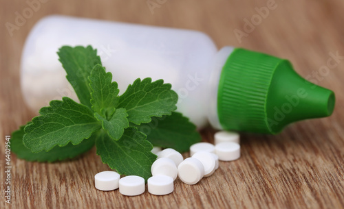 Stevia with sweetening tablets and bottle
