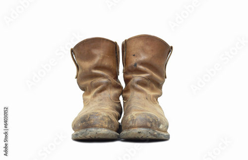 Old boots on isolated background