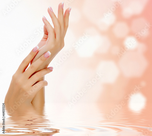 Female hands against an abstract background