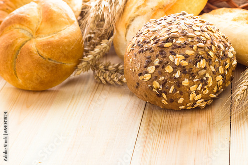 Various bakery products wooden background