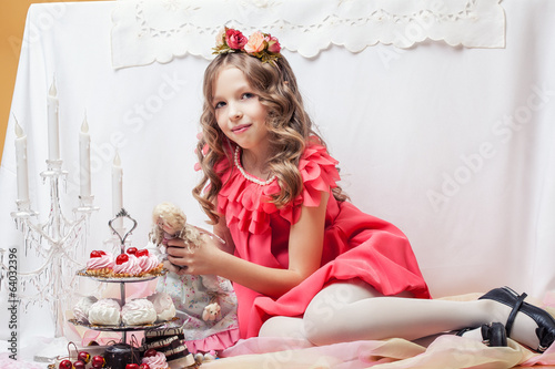 Image of beautiful little girl posing with doll