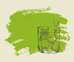 Iced tropical cocktail with mint on green grunge background
