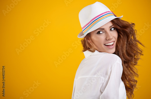 Portrait of a beautiful spring woman. Orange  background