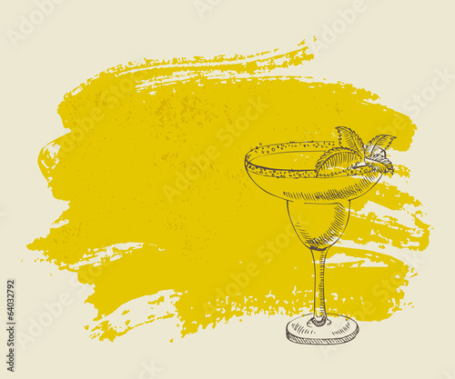 Tropical yellow cocktail with mint on yellow grunge background