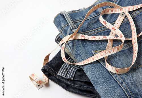 jeans with measure tape, isolated on white background