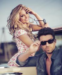 Cheerful blonde lady with handsome boyfriend