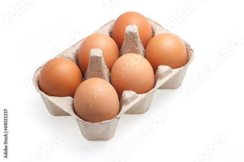 the six brown eggs isolated on white background