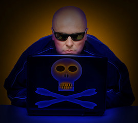 Dangerous hacker with laptop.