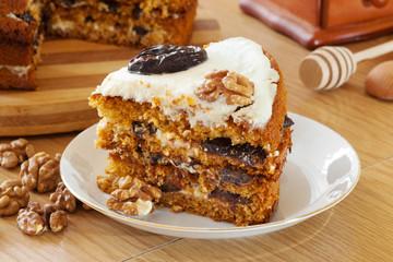 piece of honey cake with plum and walnut