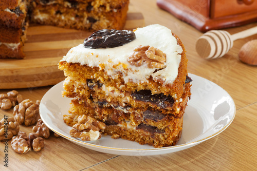 piece of honey cake with plum and walnut