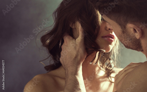 canvas print picture Sensual woman kissing her husband