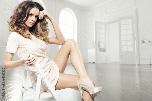 Sensual brunette woman in luxury room