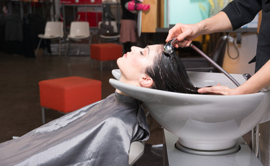 Beautiful Brunette Woman Laid Back Wash Station Shampoo Pro