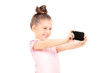 Little girl taking a selfie