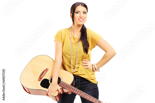 Female musician holding an acoustic guitar