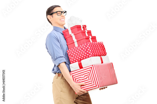 Man carrying a heavy load of gifts