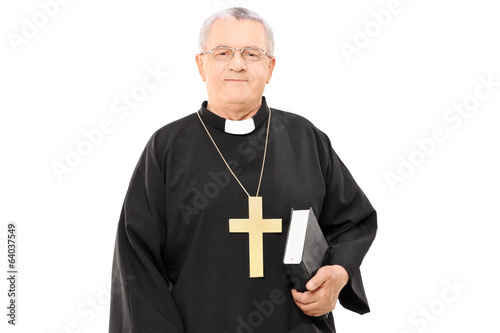 Mature priest holding a bible