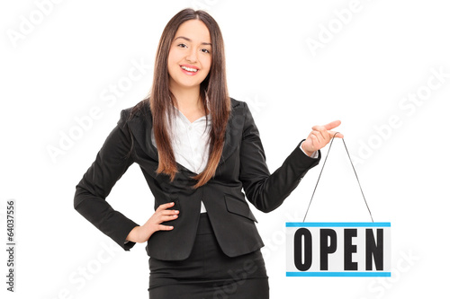 Young female retailer holding an open sign