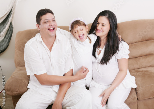 Happy American Family Playing with daughter in the living room