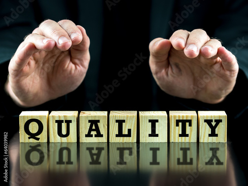 The word - Quality - on wooden cubes
