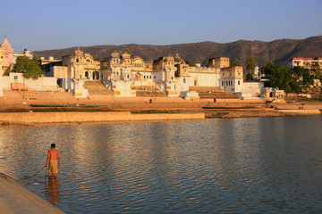 Indian man washing in holy lake, Pushkar, India