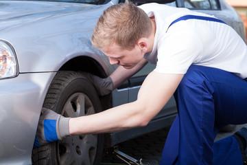 Mechanic changing car wheel