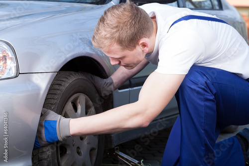 Mechanic changing car wheel