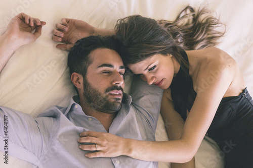 Tired Couple Lying on Bed