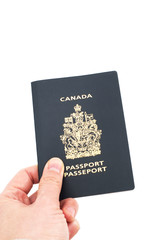 Hand holding Canadian passport isolated on white background