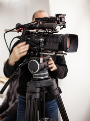 Videoperator shooting a reportage