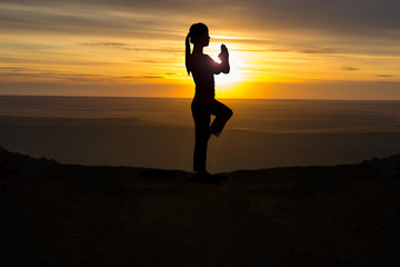 Outdoor sunrise yoga girl