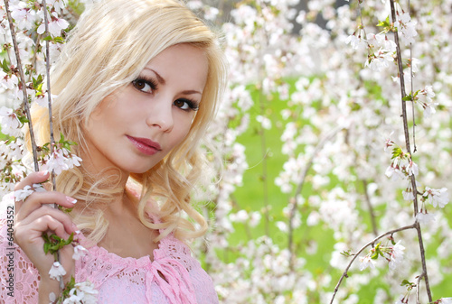 Blonde Girl with Cherry Blossom. Spring Portrait. Beautiful