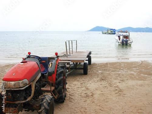 Tractor working hour at the beach