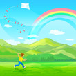 Boy running with a kite on a green meadow